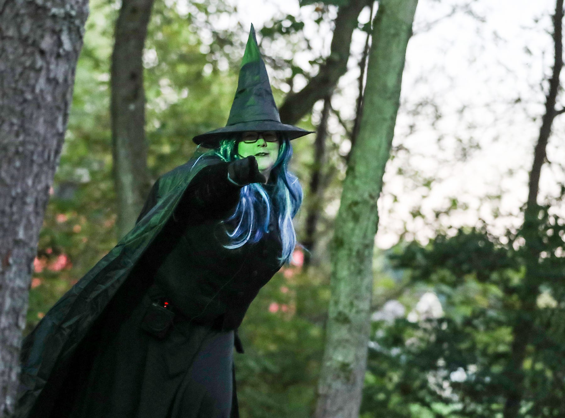 A witch is seen along the haunted hayride route on opening night of the annual Headless Horseman Halloween festival at Conner Prairie in Fishers, Ind., Thursday, Oct. 11, 2018. The festival is held from 6 to 9 p.m. every Thursday through Sunday, ending Oct. 28, 2018.