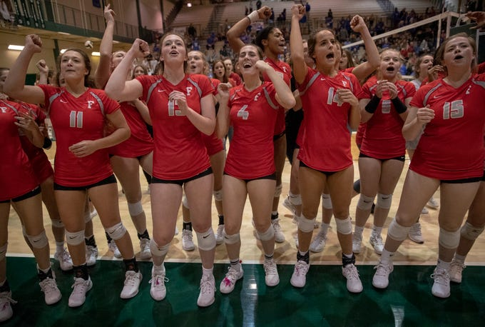 Fishers High School players sing their fight song for fans after beating rival Hamilton Southeastern High School in three straight sets in the first round of the volleyball sectional at Westfield High School, Westfield, Thursday, Oct. 11, 2018. The win matches them up with Westfield High School for a game on Saturday morning at 11a.m.