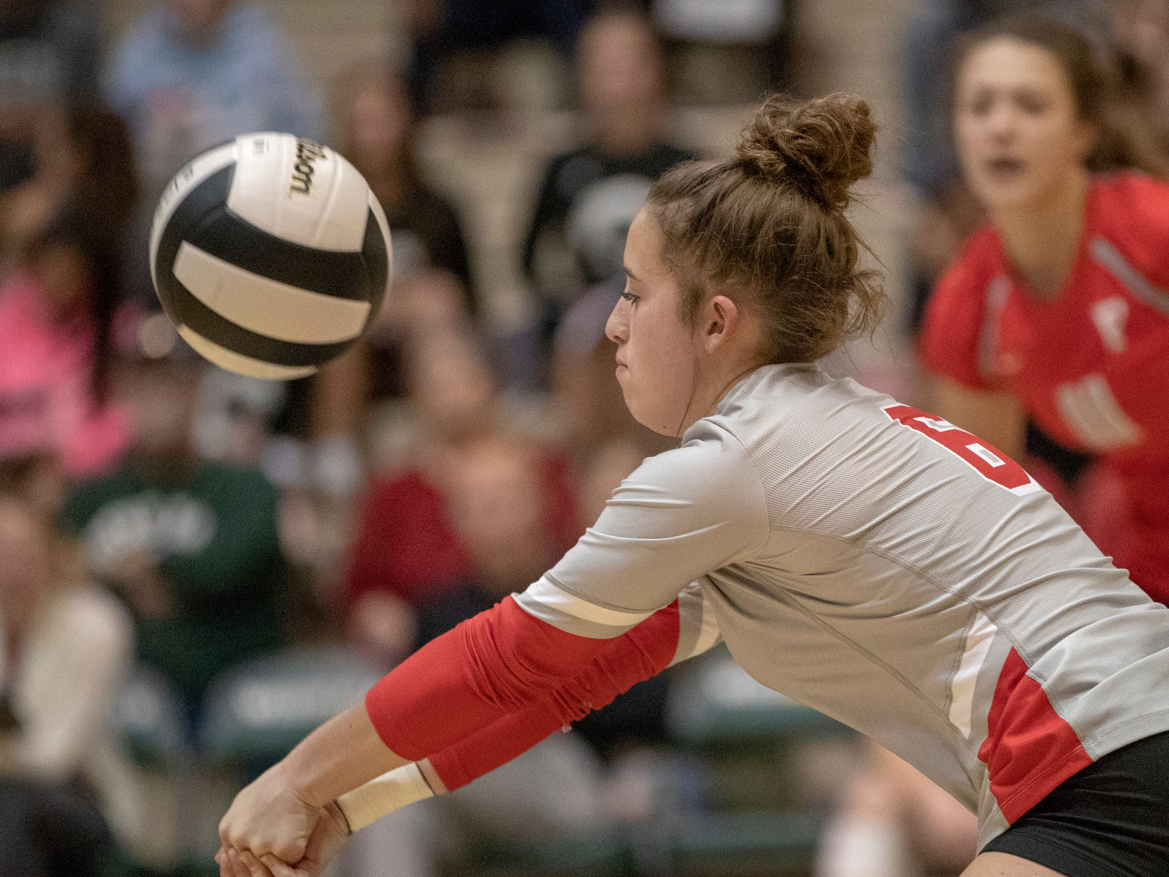 Emma Rosenberg bumps a ball as she and Fishers High School teammates defeat Hamilton Southeastern High School in three straight sets in the first round of the sectional at Westfield High School, Westfield, Thursday, Oct. 11, 2018. The win matches them up with Westfield High School for a game on Saturday morning at 11a.m.