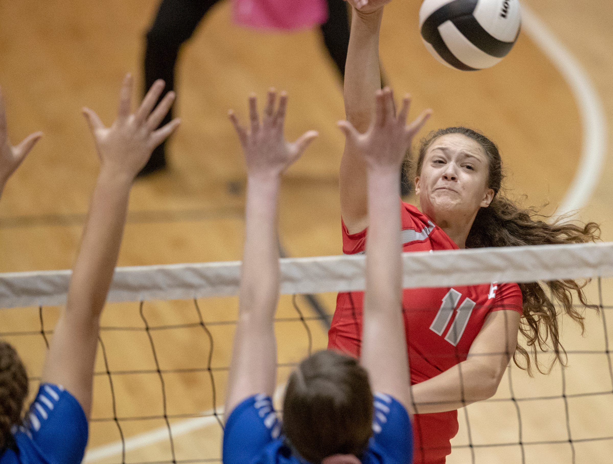 Audrey Haworth puts down a kill shot against Hamilton Southeastern High School defense as Fishers High School wins in three straight sets in the first round of the volleyball sectional at Westfield High School, Westfield, Thursday, Oct. 11, 2018. The win matches them up with Westfield High School for a game on Saturday morning at 11a.m.