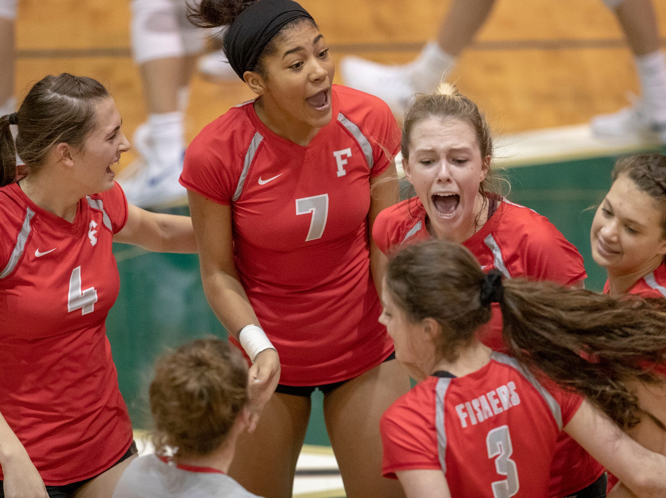 Fishers High School players celebrate during their win against Hamilton Southeastern High School in three straight sets in the first round of the volleyball sectional at Westfield High School, Westfield, Thursday, Oct. 11, 2018. The win matches them up with Westfield High School for a game on Saturday morning at 11a.m.