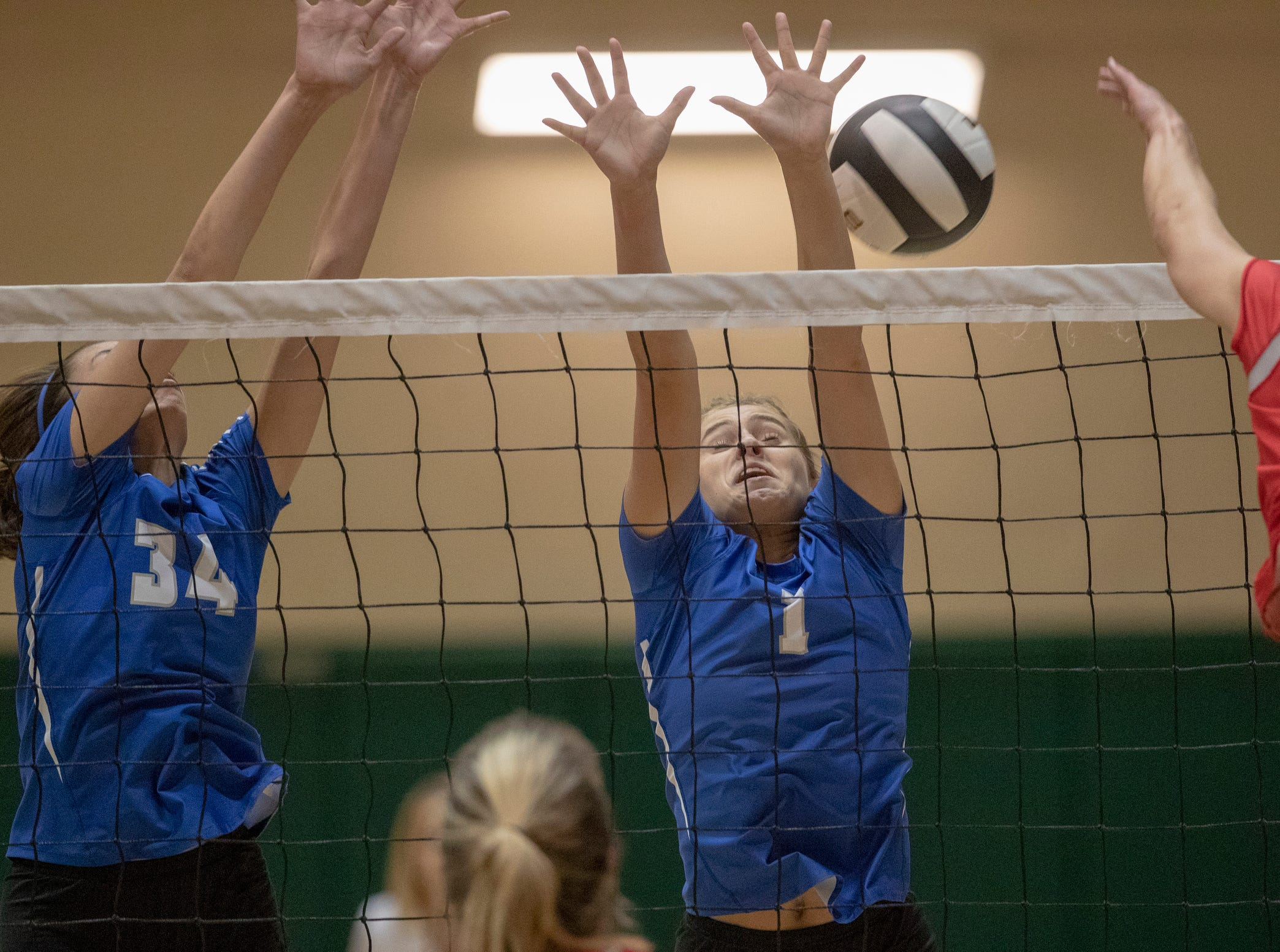 Maddie Cole (left), and Hamilton Southeastern High School teammate Grace Hunter play defense against Fishers High School, losing to FHS in three straight sets in the first round of the volleyball sectional at Westfield High School, Westfield, Thursday, Oct. 11, 2018. The win matches them up with Westfield High School for a game on Saturday morning at 11a.m.