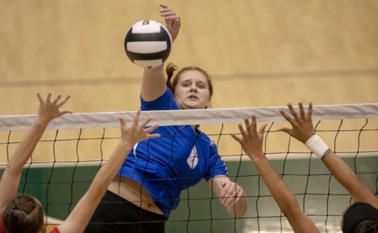Delaney Garner puts down a kill attempt for Hamilton Southeastern High School as they lose to Fishers High School in three straight sets in the first round of the volleyball sectional at Westfield High School, Westfield, Thursday, Oct. 11, 2018. The win matches them up with Westfield High School for a game on Saturday morning at 11a.m.