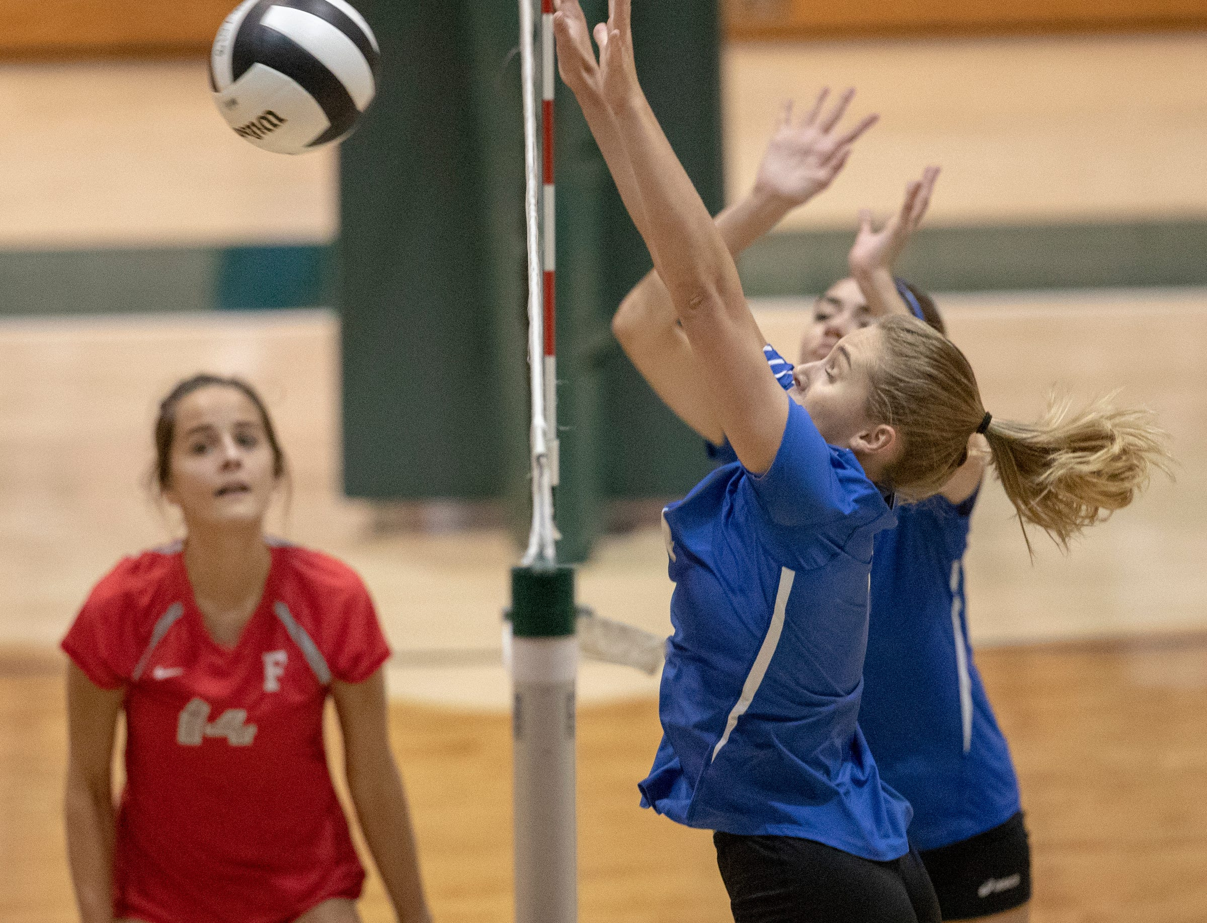 Hamilton Southeastern High School defenders work against a shot from Fishers High School as they lost to FHS in three straight sets in the first round of the volleyball sectional at Westfield High School, Westfield, Thursday, Oct. 11, 2018. The win matches them up with Westfield High School for a game on Saturday morning at 11a.m.