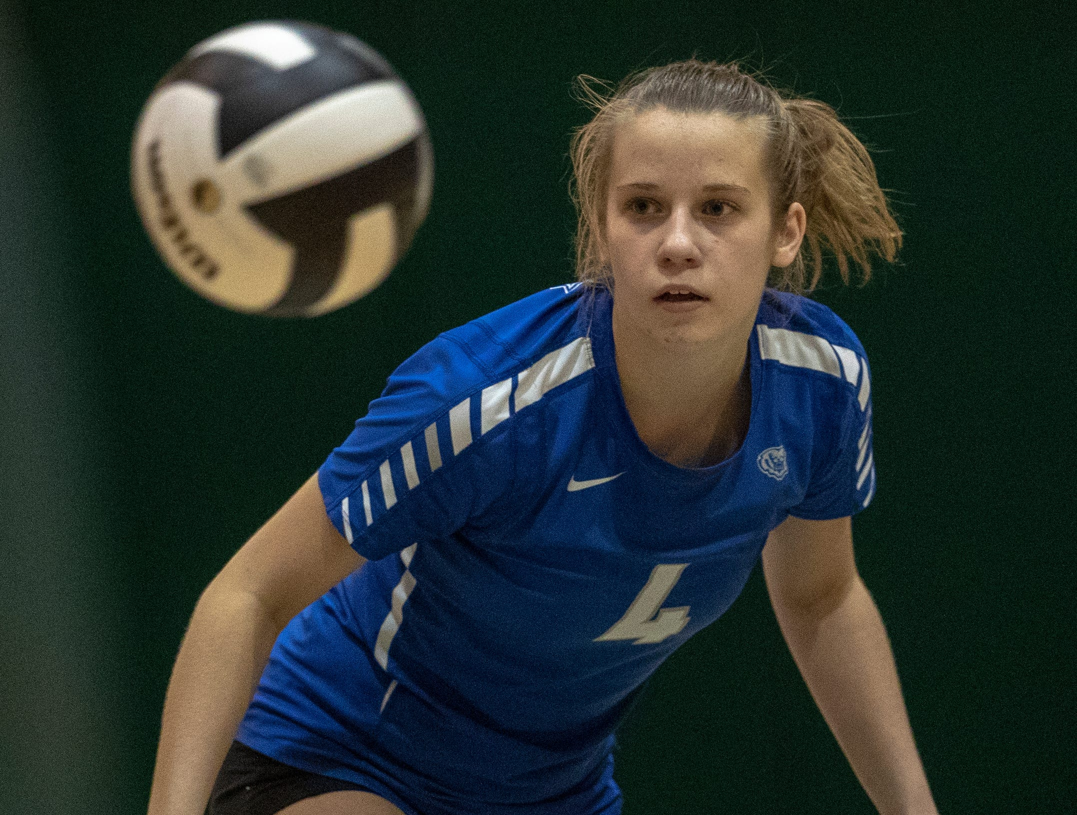 Kyla Berg of Hamilton Southeastern High School eyes a ball as they play Fishers High School, losing to FHS in three straight sets in the first round of the volleyball sectional at Westfield High School, Westfield, Thursday, Oct. 11, 2018. The win matches them up with Westfield High School for a game on Saturday morning at 11a.m.