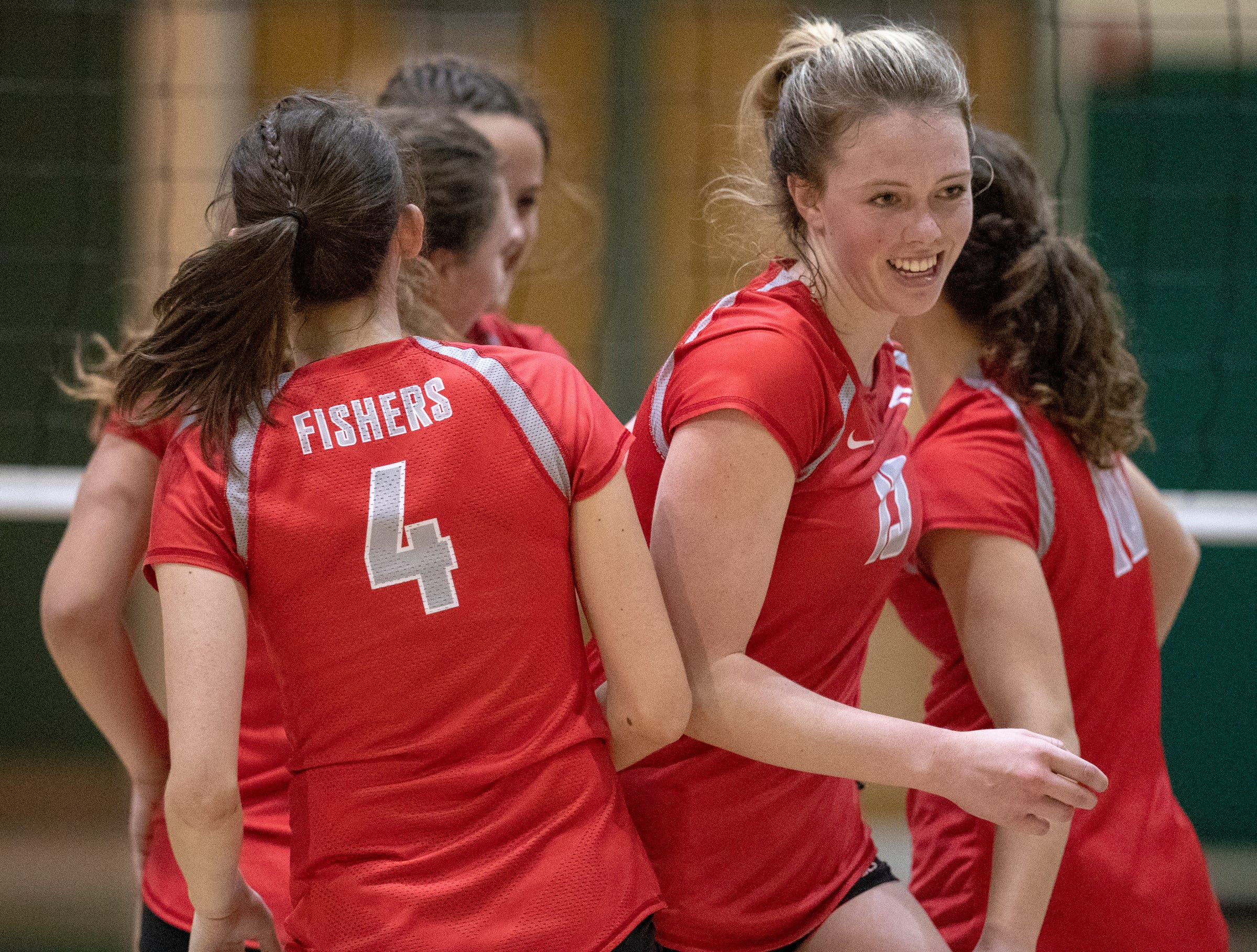 Rose Duffy of Fishers High School is all smiles during a huddle as they play Hamilton Southeastern High School, winning in three straight sets in the first round of the volleyball sectional at Westfield High School, Westfield, Thursday, Oct. 11, 2018. The win matches them up with Westfield High School for a game on Saturday morning at 11a.m.