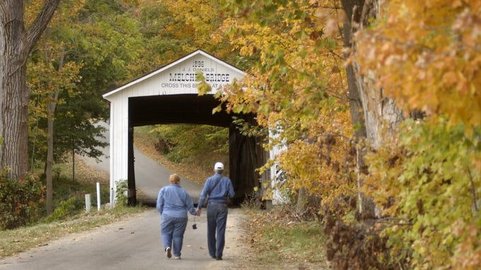 Corky and Les Rice of Danville, IN walk hand-in-hand as they approach the Melcher Bridge, one of the 32 covered bridges in Parke County in 2004.
