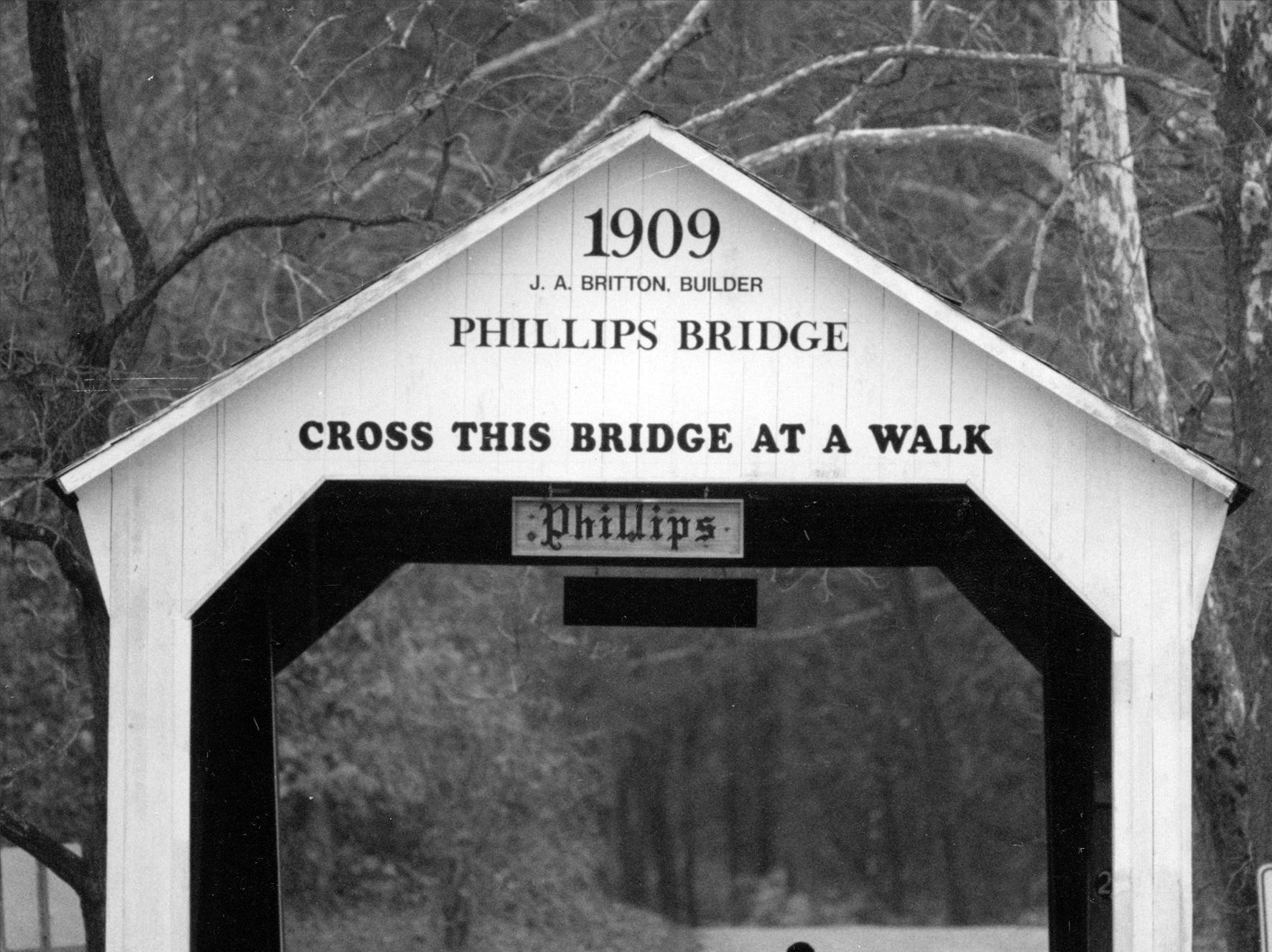 A man takes a stroll across the Phillips covered bridge which spans Big Pond Creek near Rockville in Park County in 1992.