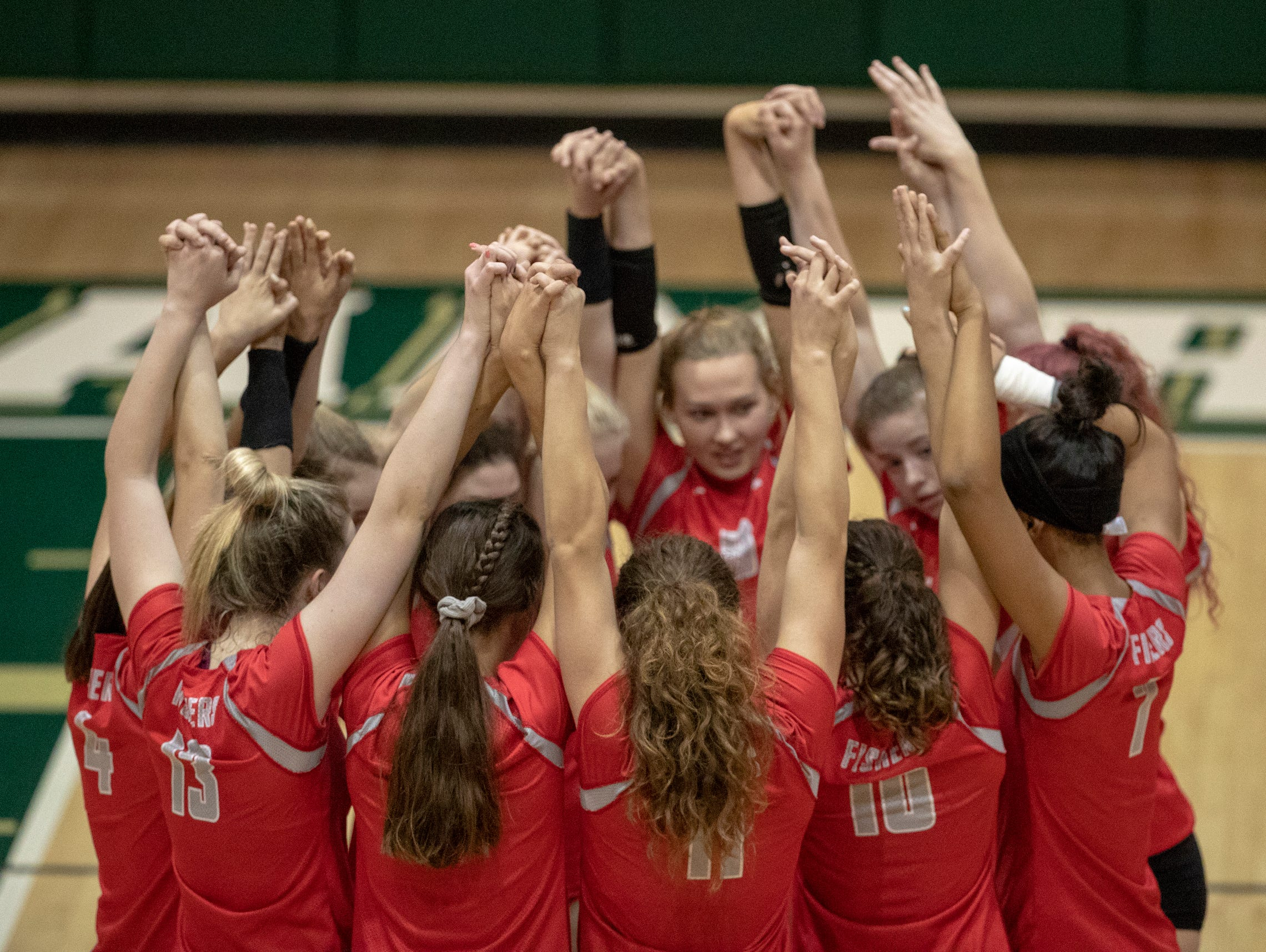 Fishers High School huddles up en route to defeating rival Hamilton Southeastern High School in three straight sets in the first round of the volleyball sectional at Westfield High School, Westfield, Thursday, Oct. 11, 2018. The win matches them up with Westfield High School for a game on Saturday morning at 11a.m.