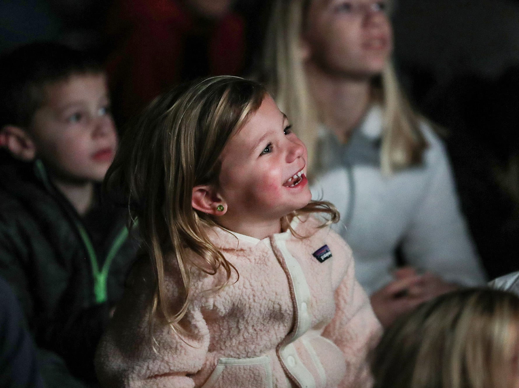 Children laugh at a marionette show by Stevens Puppets on opening night of the annual Headless Horseman Halloween festival at Conner Prairie in Fishers, Ind., Thursday, Oct. 11, 2018. The festival is held from 6 to 9 p.m. every Thursday through Sunday, ending Oct. 28, 2018.