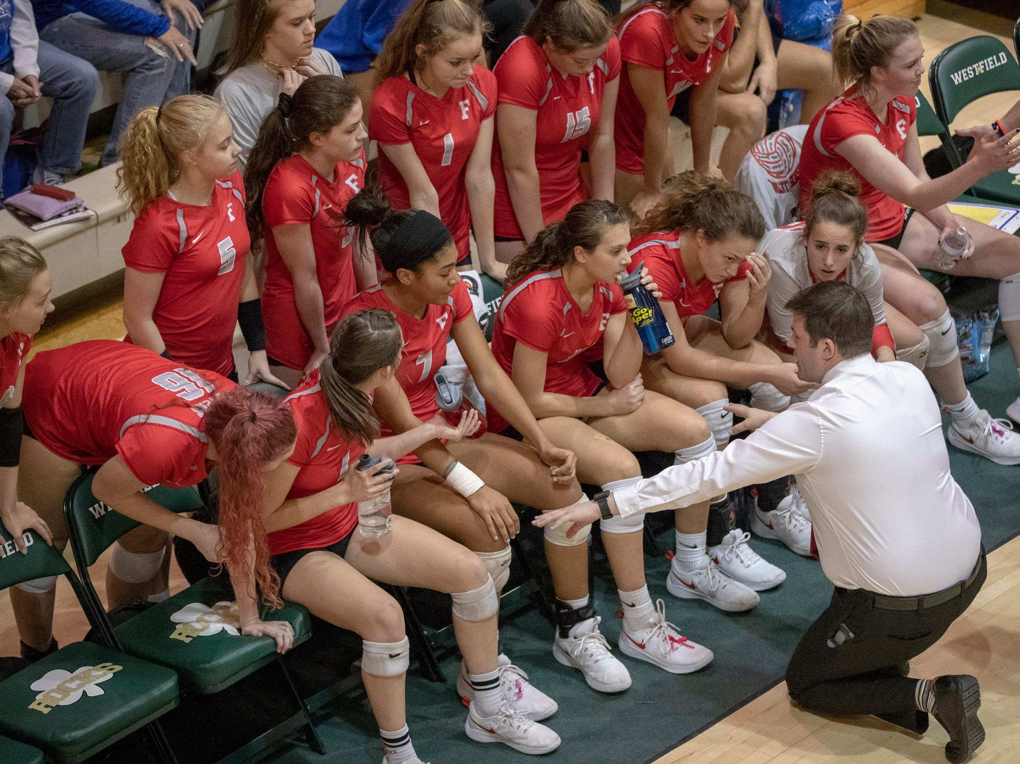 Fishers High School huddles up during a timeout as they work on defeating Hamilton Southeastern High School in three straight sets in the first round of the sectional at Westfield High School, Westfield, Thursday, Oct. 11, 2018. The win matches them up with Westfield High School for a game on Saturday morning at 11a.m.