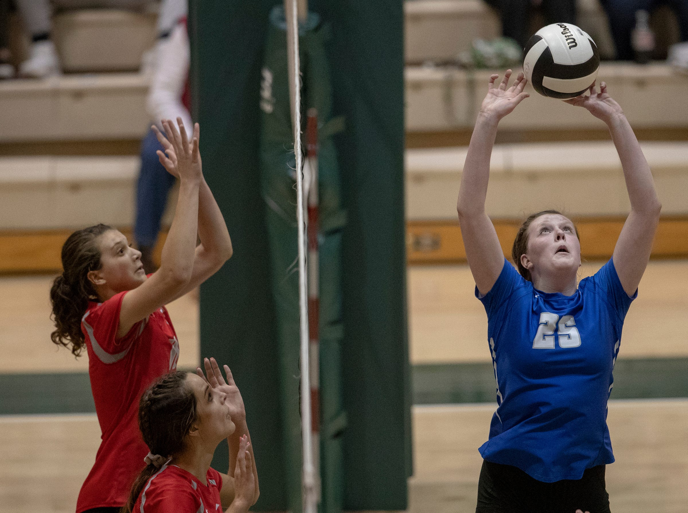 Olivia Phillips of Hamilton Southeastern High School sets a ball for a teammate as they play Fishers High School, losing in three straight sets in the first round of the volleyball sectional at Westfield High School, Westfield, Thursday, Oct. 11, 2018. The win matches them up with Westfield High School for a game on Saturday morning at 11a.m.
