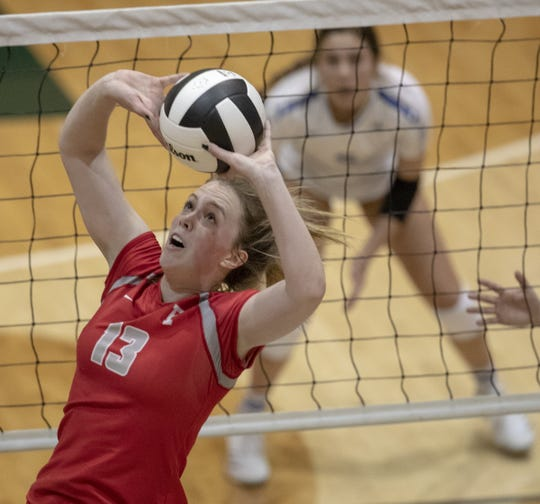 Rose Duffy sets a ball for a teammate as her Fishers High School team beat Hamilton Southeastern High School in three straight sets in the first round of the volleyball sectional at Westfield High School, Westfield, Thursday, Oct. 11, 2018. The win matches them up with Westfield High School for a game on Saturday morning at 11a.m.