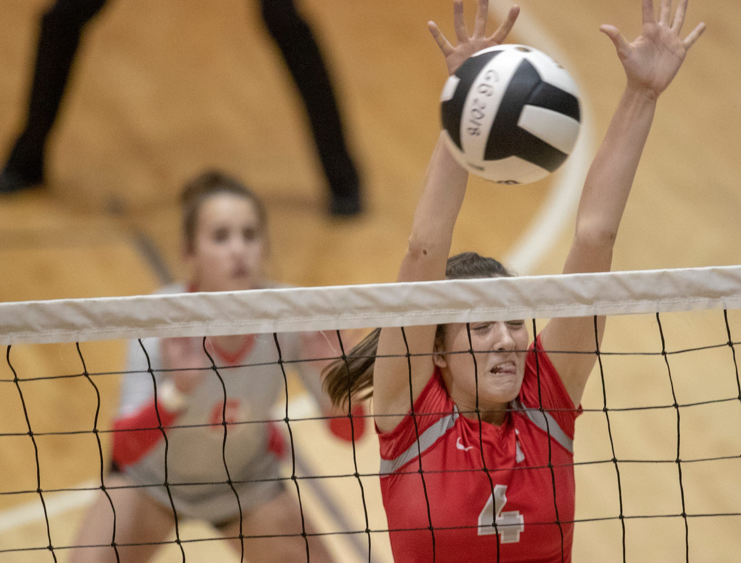 Bryneth Roberts blocks a shot for Fishers High School as her team beats Hamilton Southeastern High School in three straight sets in the first round of the volleyball sectional at Westfield High School, Westfield, Thursday, Oct. 11, 2018. The win matches them up with Westfield High School for a game on Saturday morning at 11a.m.