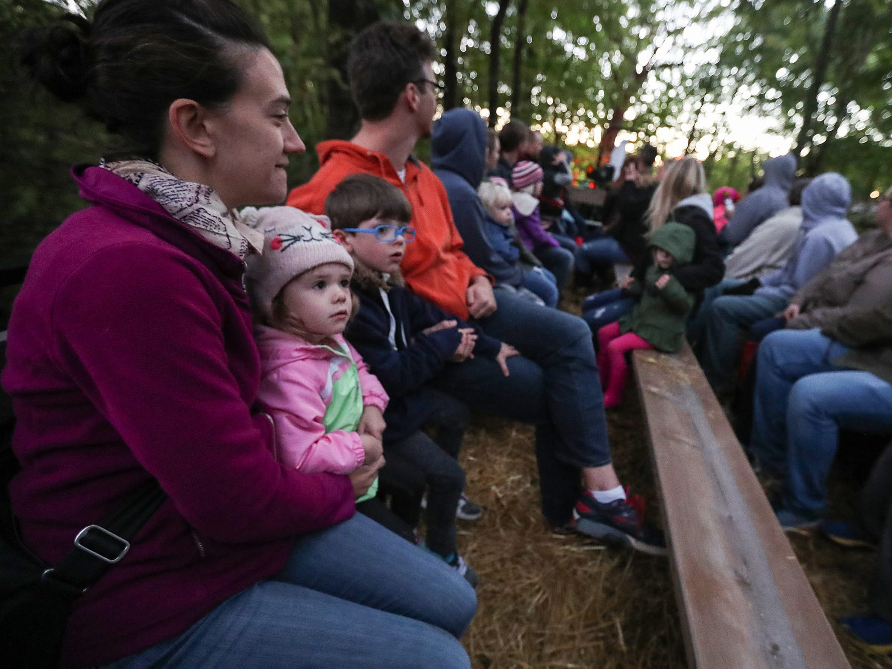 A wagon carries guests on a spooky forest ride on opening night of the annual Headless Horseman Halloween festival at Conner Prairie in Fishers, Ind., Thursday, Oct. 11, 2018. The festival is held from 6 to 9 p.m. every Thursday through Sunday, ending Oct. 28, 2018.
