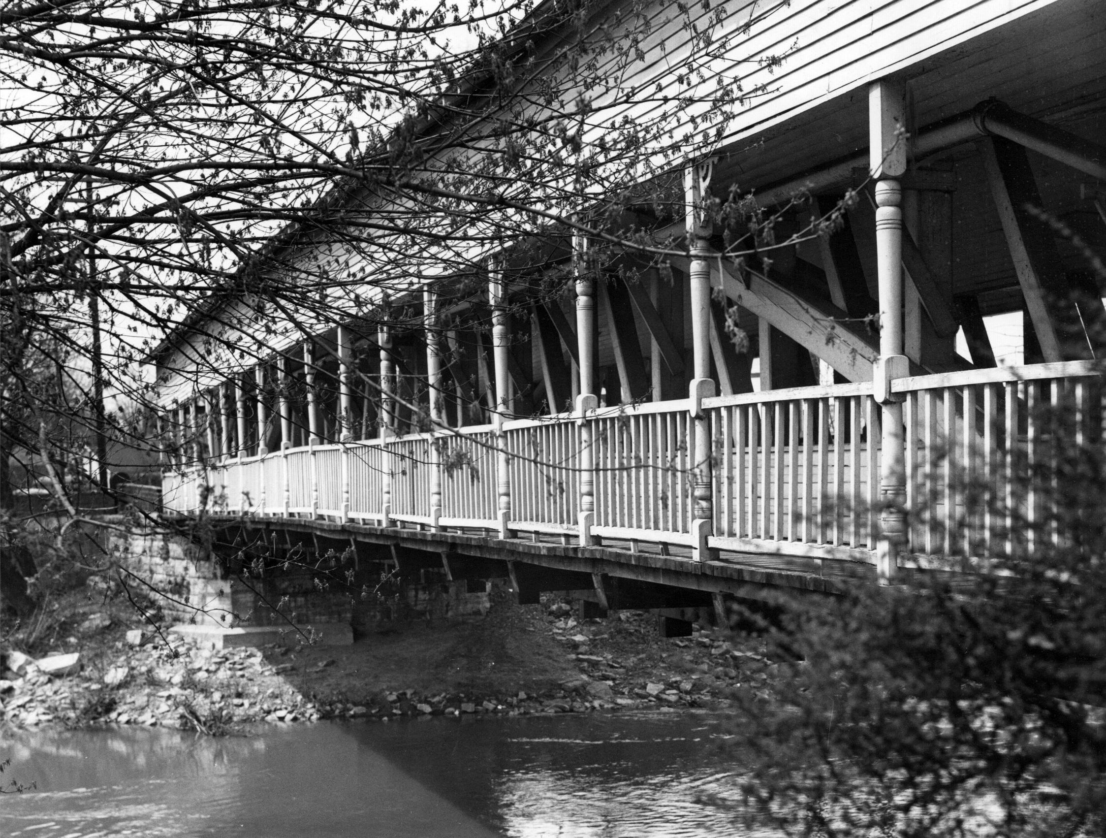 Cedar Ford Covered Bridge that once spanned the Little Blue River north of Shelbyville in 1951. The bridge was removed in 1975 to make way for a new bridge and put into storage until 2015 when it was moved to Monroe County to replace a bridge that burned in 1976 over Bean Blossom Creek.