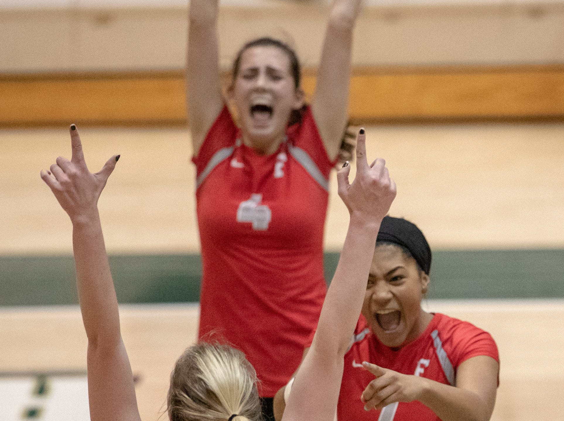 Fishers High School players celebrate during action against Hamilton Southeastern High School in which they won in three straight sets in the first round of the volleyball sectional at Westfield High School, Westfield, Thursday, Oct. 11, 2018. The win matches them up with Westfield High School for a game on Saturday morning at 11a.m.