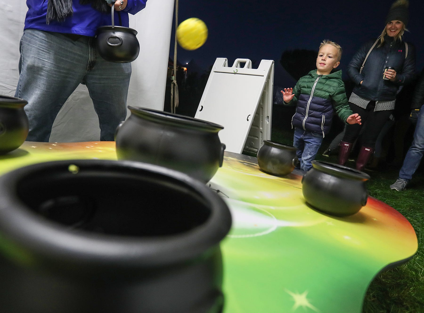Children enjoy games on opening night of the annual Headless Horseman Halloween festival at Conner Prairie in Fishers, Ind., Thursday, Oct. 11, 2018. The festival is held from 6 to 9 p.m. every Thursday through Sunday, ending Oct. 28, 2018.