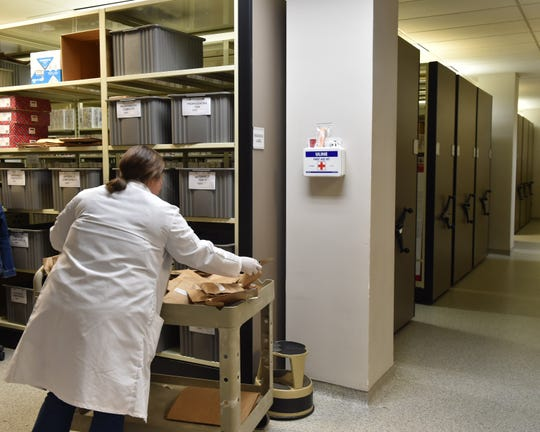An evidence analyst processes evidence at Mississipi Crime Lab in Jackson. Thursday, Oct. 11, 2018.