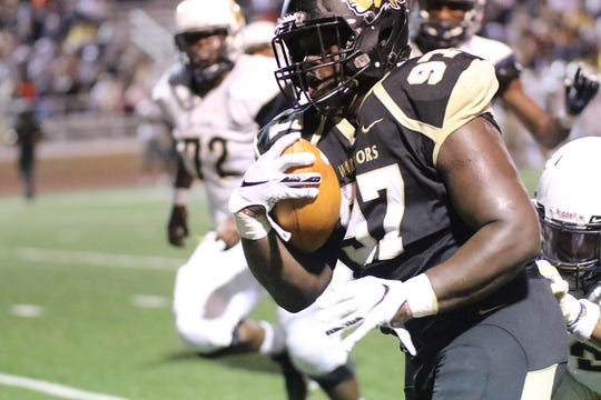 East Central defensive lineman Alvin Dempsey III rambles toward the end zone on a second quarter scoop and score against Gulf Coast for ECCC's only first-half score in a 27-14 loss Thursday night.
