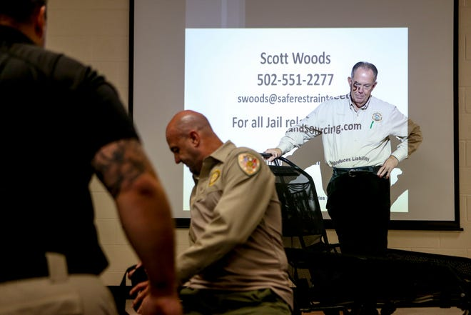 """Madison County Sheriff's office Captain Rudder watches as deputies practice deployment of the restraint system during a training session for """"The Wrap"""" at West Tennessee Regional Training Center in Jackson, Tenn., on Friday, Oct. 12, 2018."""