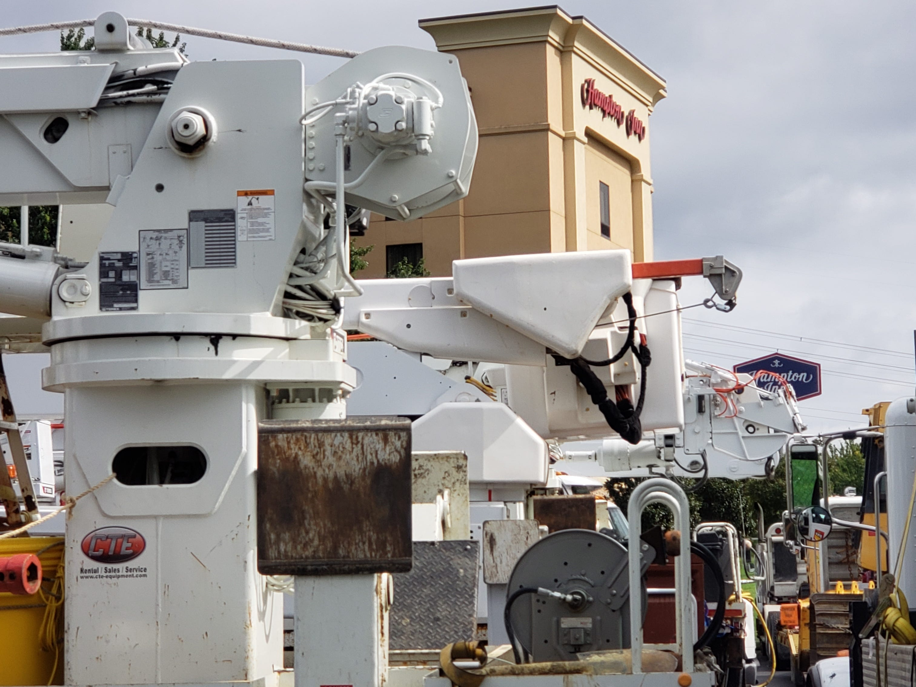 Electric and road crew trucks wait Thursday near a Knoxville Hampton Inn on Executive Drive to travel to Florida and the Carolinas for Hurricane Michael aid.