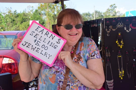 Cheryl Snyder with Paparazzi Accessories was on hand with necklaces, earrings, bracelets and more for every shopper at a rummage sale held by the Karns High School Baseball Boosters at the Lions Club parking lot Saturday, Oct. 6.