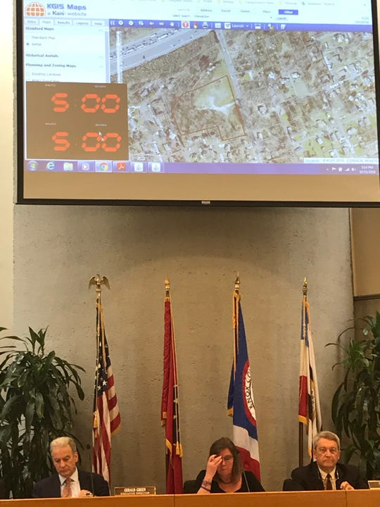 Planning officials sit below a schematic of an affordable apartment site in Pond Gap on Oct. 11, 2018.