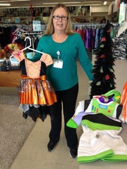 Assistant manager Sandra Marie Kelly shows off Halloween items at Goodwill, at 4201 Chapman Highway.