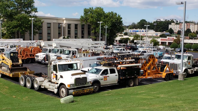 Dozens of work trucks park in a Knoxville hotel lot on Executive Drive  on Oct. 11, 2018. The trucks were waiting to be deployed for Hurricane Michael relief.