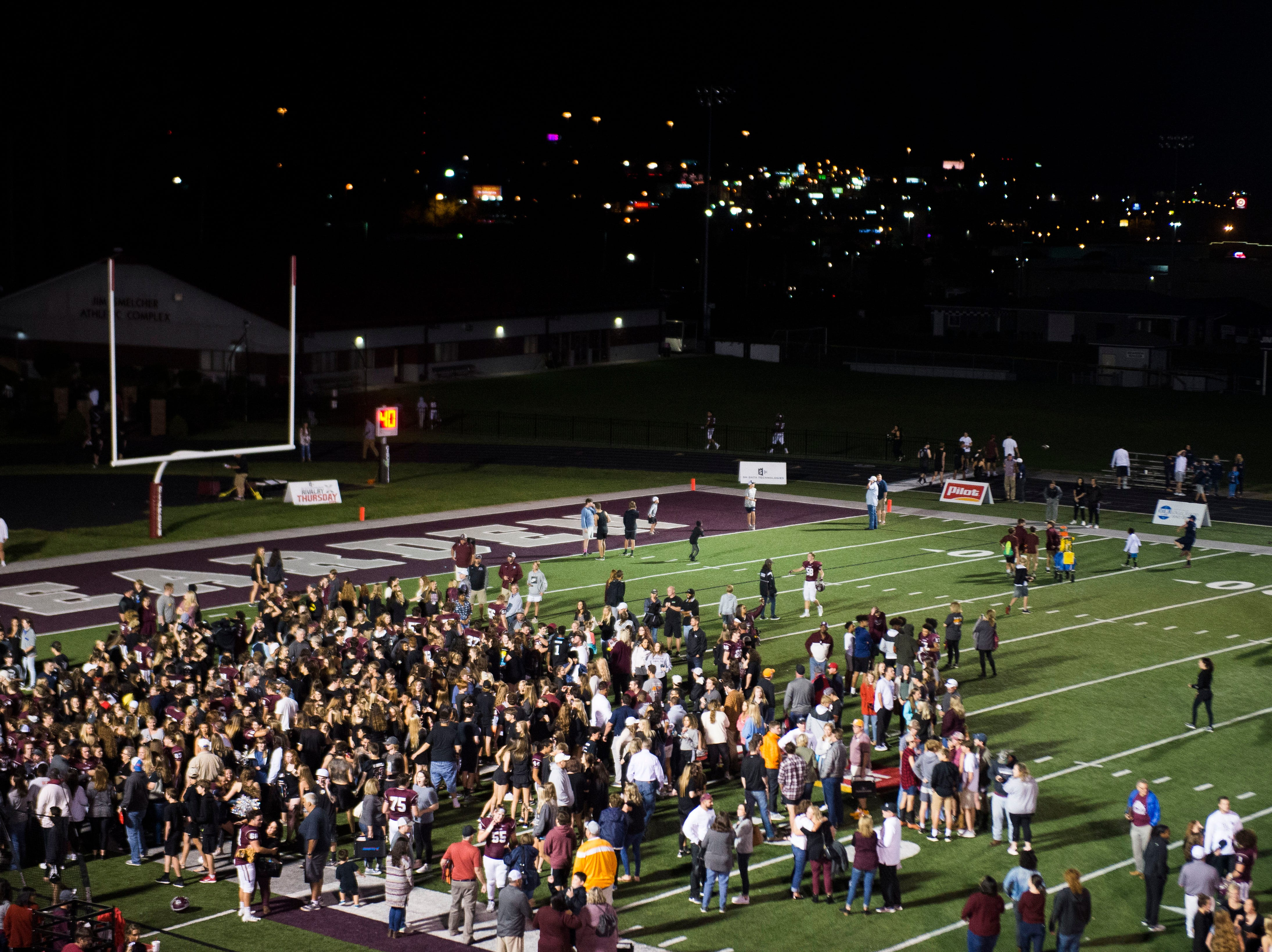 Bearden fans swarm the field after a game between Bearden and Farragut at Bearden Thursday, Oct. 11, 2018. Bearden took down Farragut 17-13.