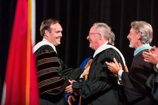 Dr. James Hurley, left, Tusculum University's president, greets U.S. Sen. Lamar Alexander, center, and Dr. Claude O. Pressnell Jr., president of the Tennessee Independent Colleges and Universities Association.