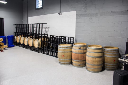 Barrels of sour beer are stored at a building at 109 W. Anderson Ave. on Oct. 10, 2018. The building is the soon-to-be-home of The Outpost music venue and the future home of a new sour beer facility by Abridged.