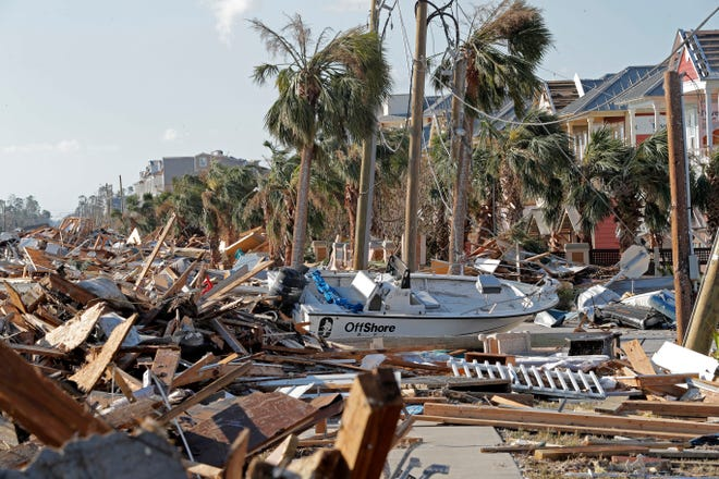 Destruction is seen in the aftermath of Hurricane Michael in Mexico Beach, Fla., Thursday, Oct. 11, 2018. The devastation inflicted by Hurricane Michael came into focus Thursday with rows upon rows of homes found smashed to pieces, and rescue crews began making their way into the stricken areas in hopes of accounting for hundreds of people who may have stayed behind.