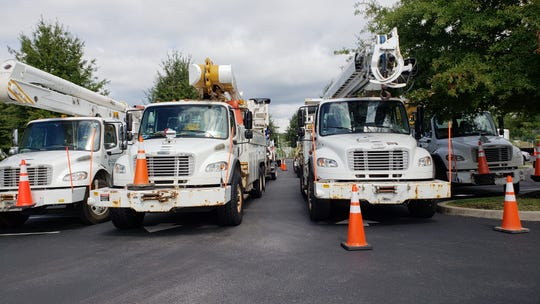 Trucks wait to be deployed from a Knoxville hotel parking lot to areas affected by Hurricane Michael on Oct. 11, 2018.