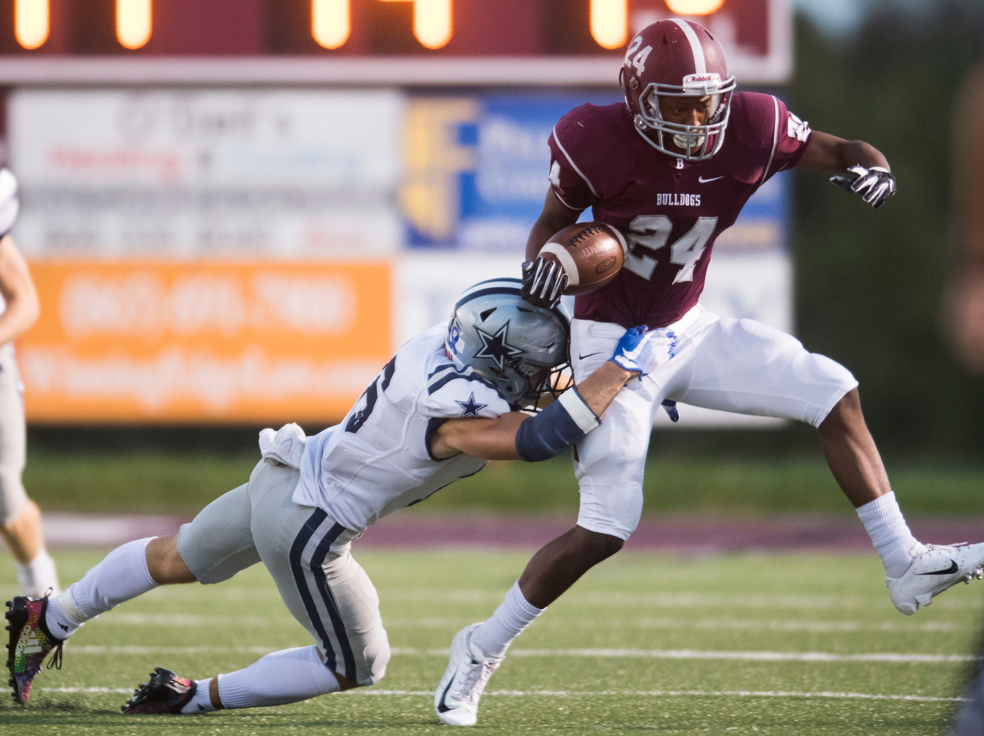 Bearden's DJ Cox (24) is taken down by Farragut's Tanner Corum (16) during a game between Bearden and Farragut at Bearden Thursday, Oct. 11, 2018. Bearden took down Farragut 17-13.