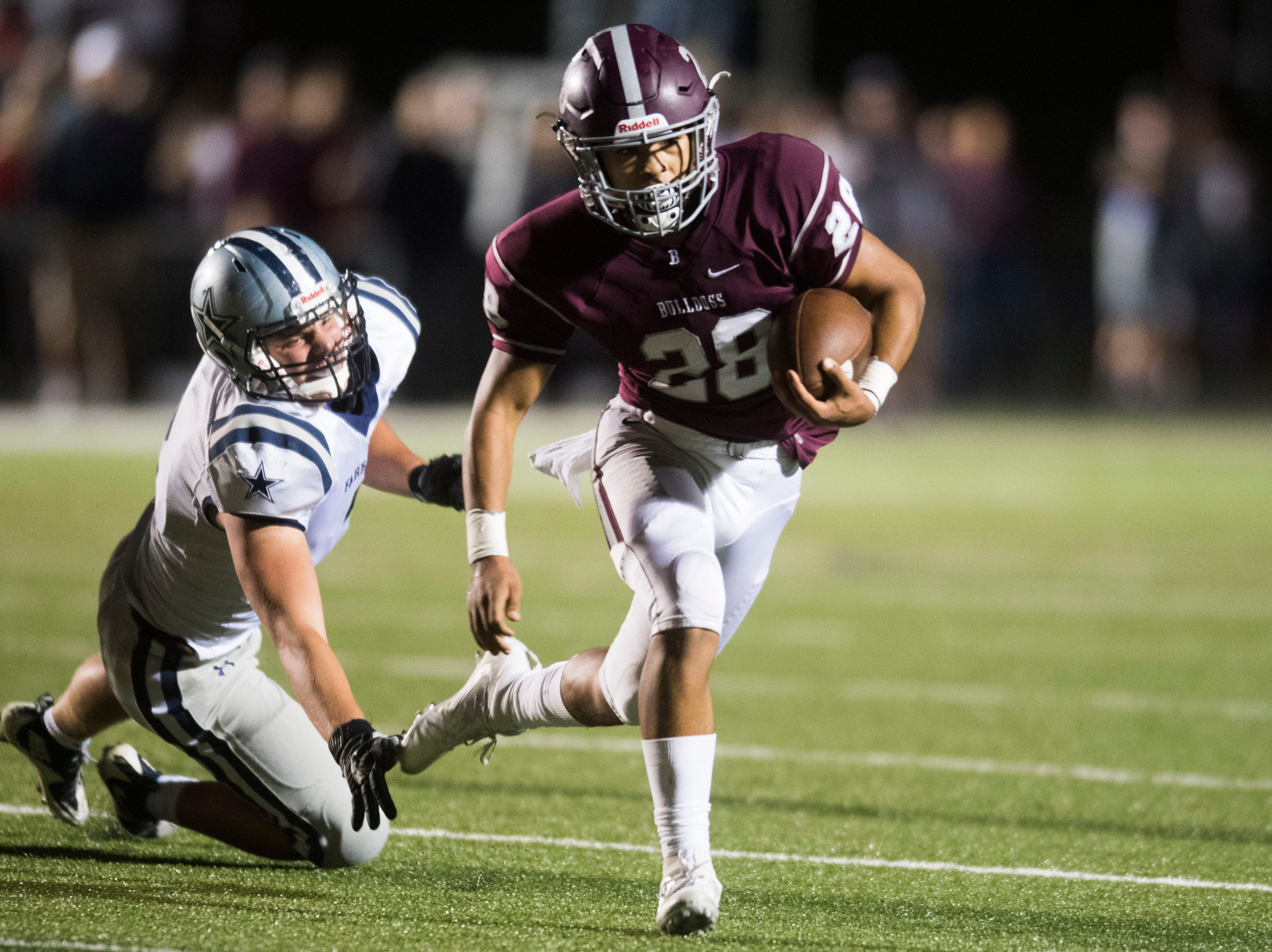 Bearden's Makai Williams (28) runs the ball during a game between Bearden and Farragut at Bearden Thursday, Oct. 11, 2018. Bearden took down Farragut 17-13.