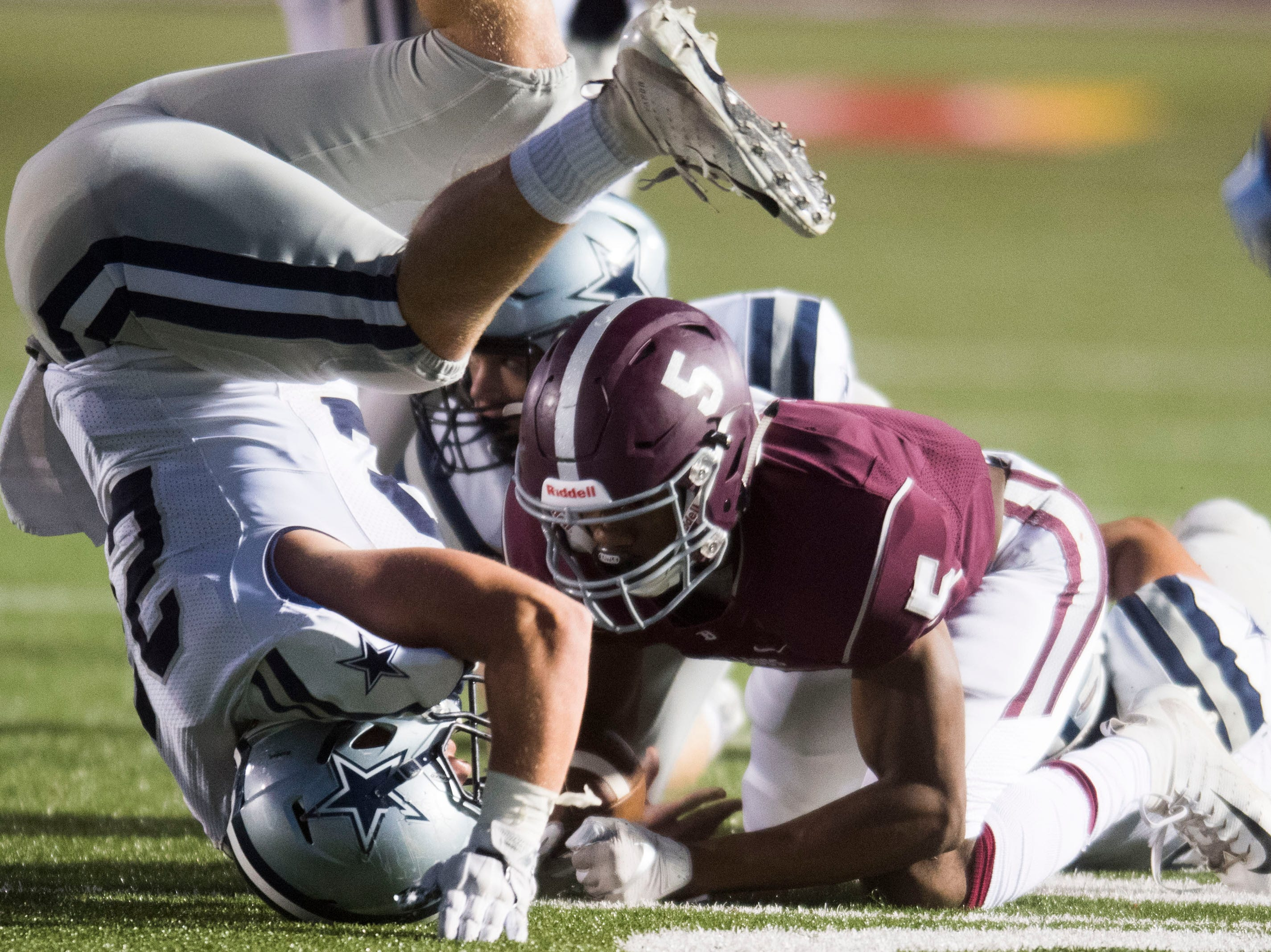Bearden's Kahlil Abdullah (5) is tackled by a Farragut player during a game between Bearden and Farragut at Bearden Thursday, Oct. 11, 2018. Bearden took down Farragut 17-13.