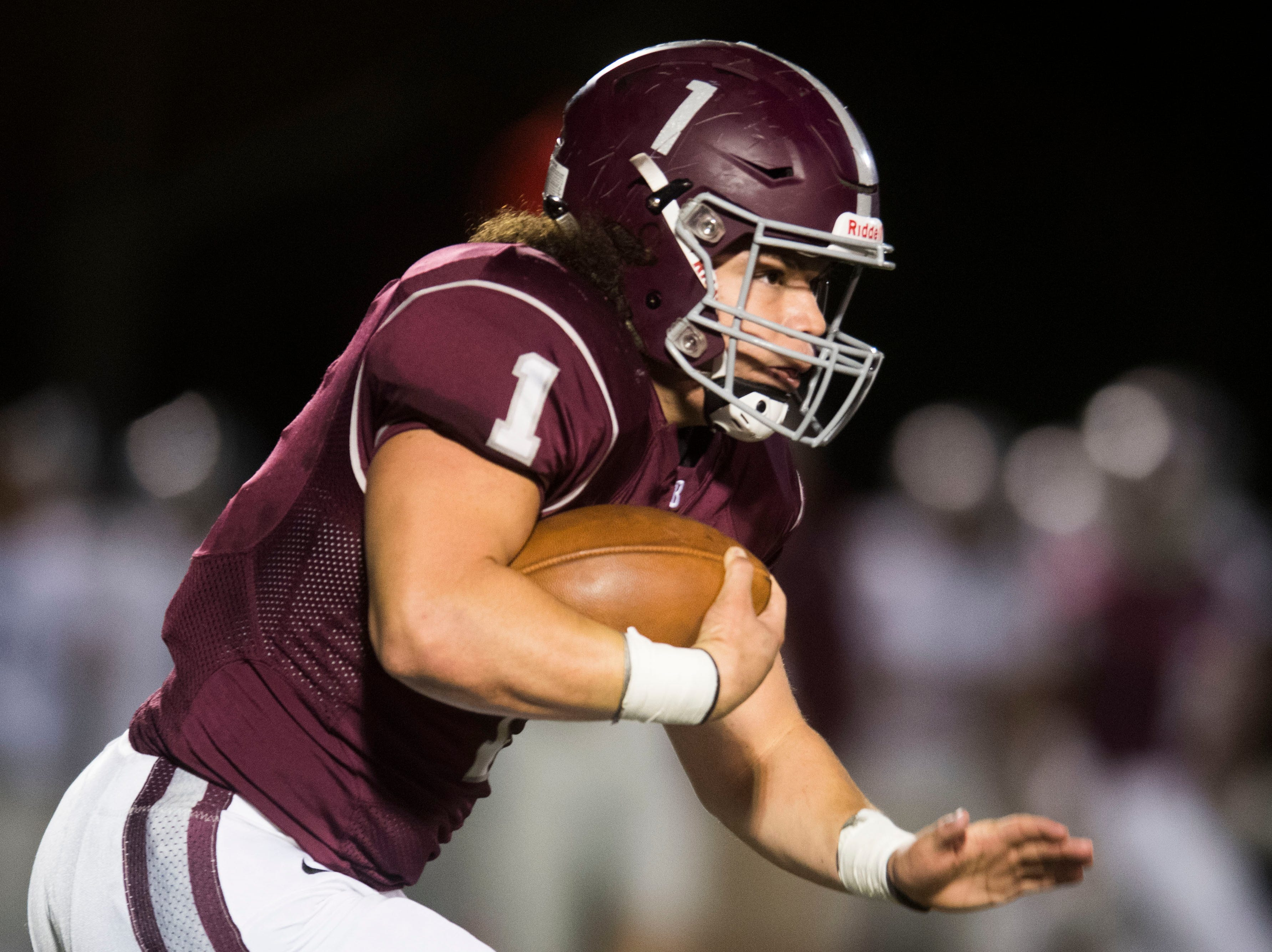 Bearden's Caleb Wilkins (1) runs the ball during a game between Bearden and Farragut at Bearden Thursday, Oct. 11, 2018. Bearden took down Farragut 17-13.