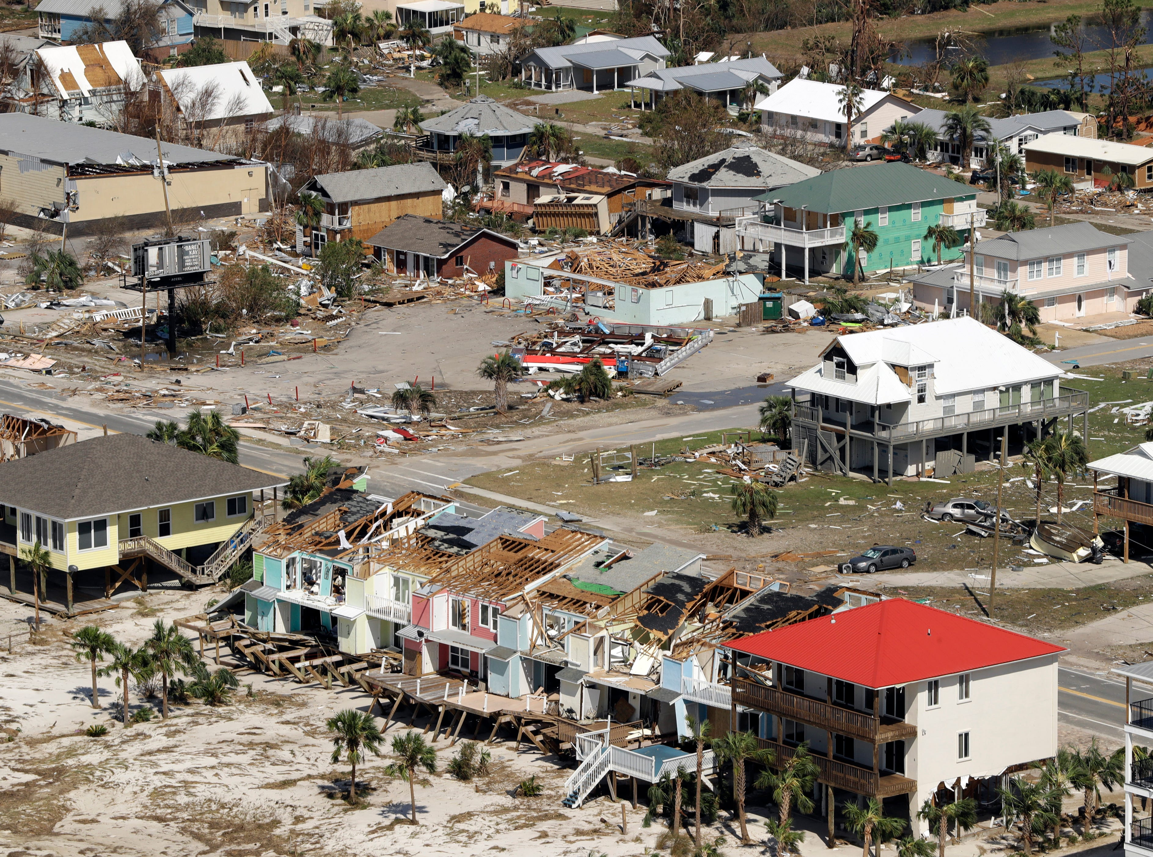 Homes destroyed by Hurricane Michael are shown in this aerial photo Thursday, Oct. 11, 2018, in Mexico Beach, Fla. The devastation inflicted by Hurricane Michael came into focus Thursday with rows upon rows of homes found smashed to pieces, and rescue crews began making their way into the stricken areas in hopes of accounting for hundreds of people who may have stayed behind.
