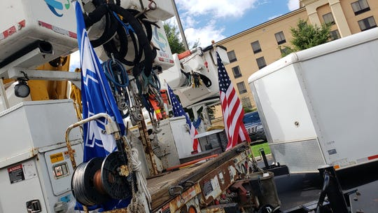 Trucks display an American flag Thursday as they wait to be deployed to areas affected by Hurricane Michael.