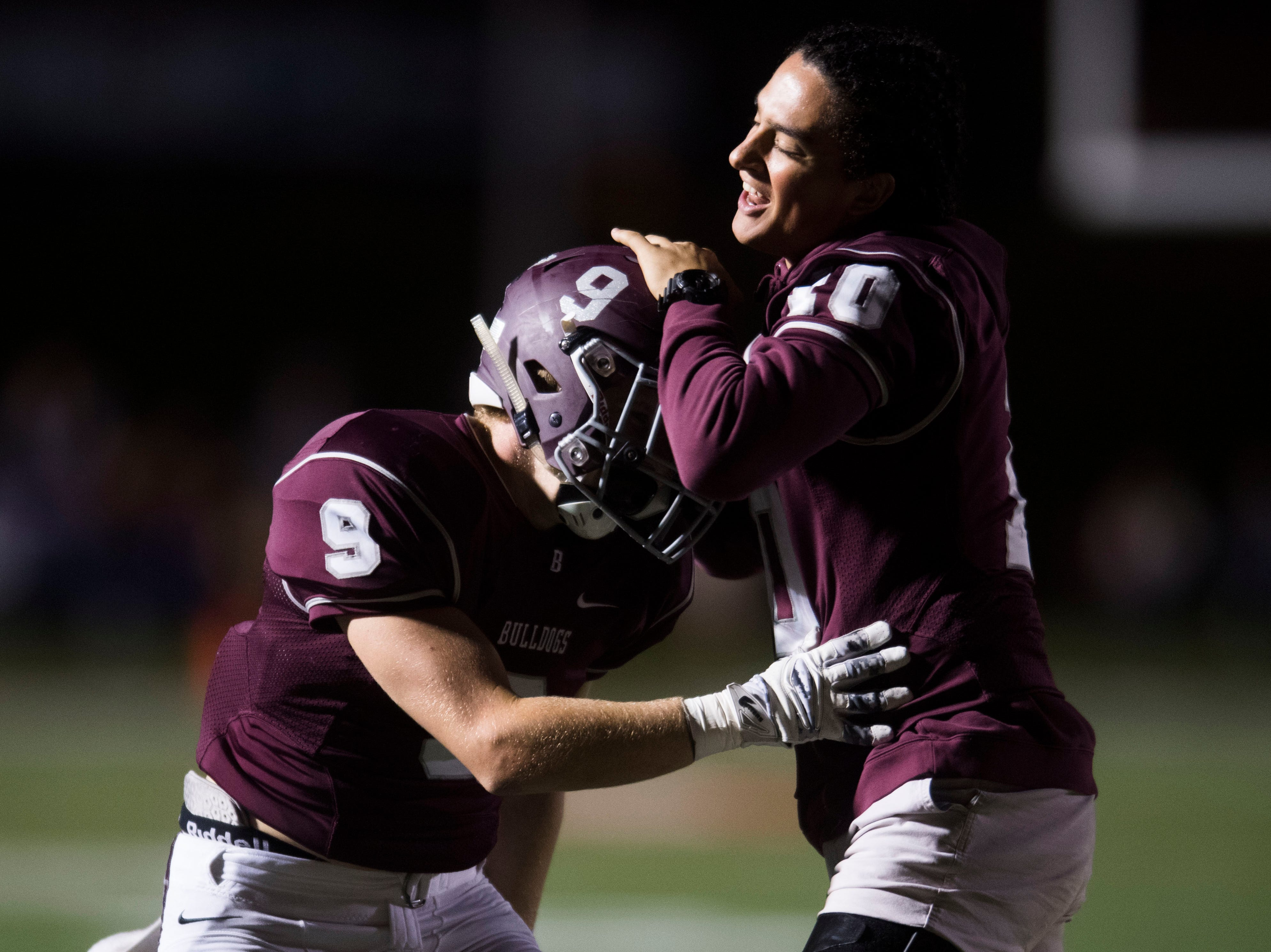 Bearden's Jackson Biggs (9) celebrates with a teammate during a game between Bearden and Farragut at Bearden Thursday, Oct. 11, 2018. Bearden took down Farragut 17-13.