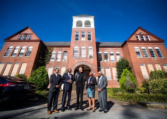From left, Joseph Kendrick, Johnny Ford, Bob Booker, C. Virginia Fields, Dr. Rev. James Reese and Howard O'Neil speak in front of McKee Hall on Knoxville College's campus on Friday, October 12, 2018.