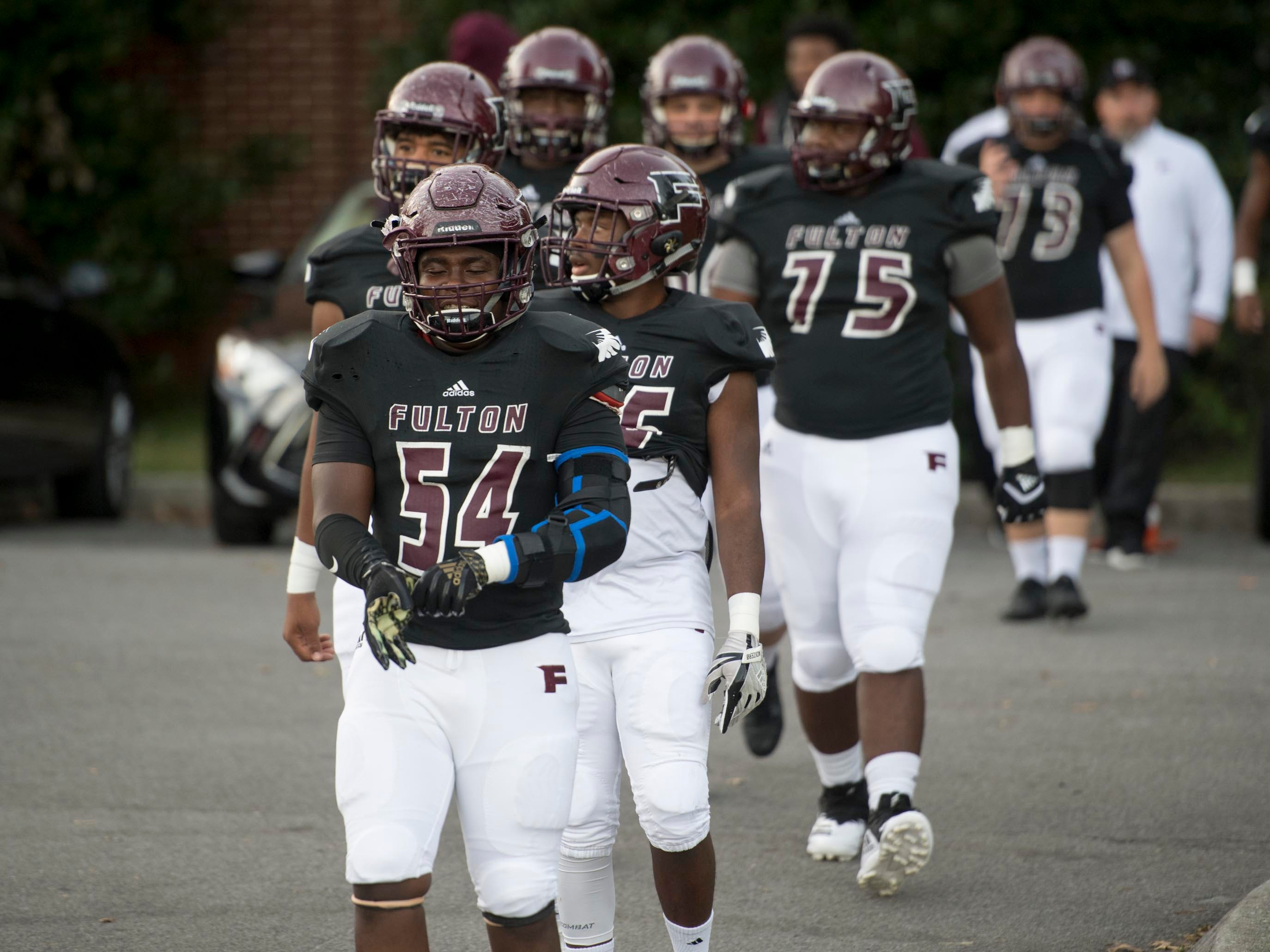 Fulton linemen approach the field for the football game against Campbell County on Friday, October 12, 2018