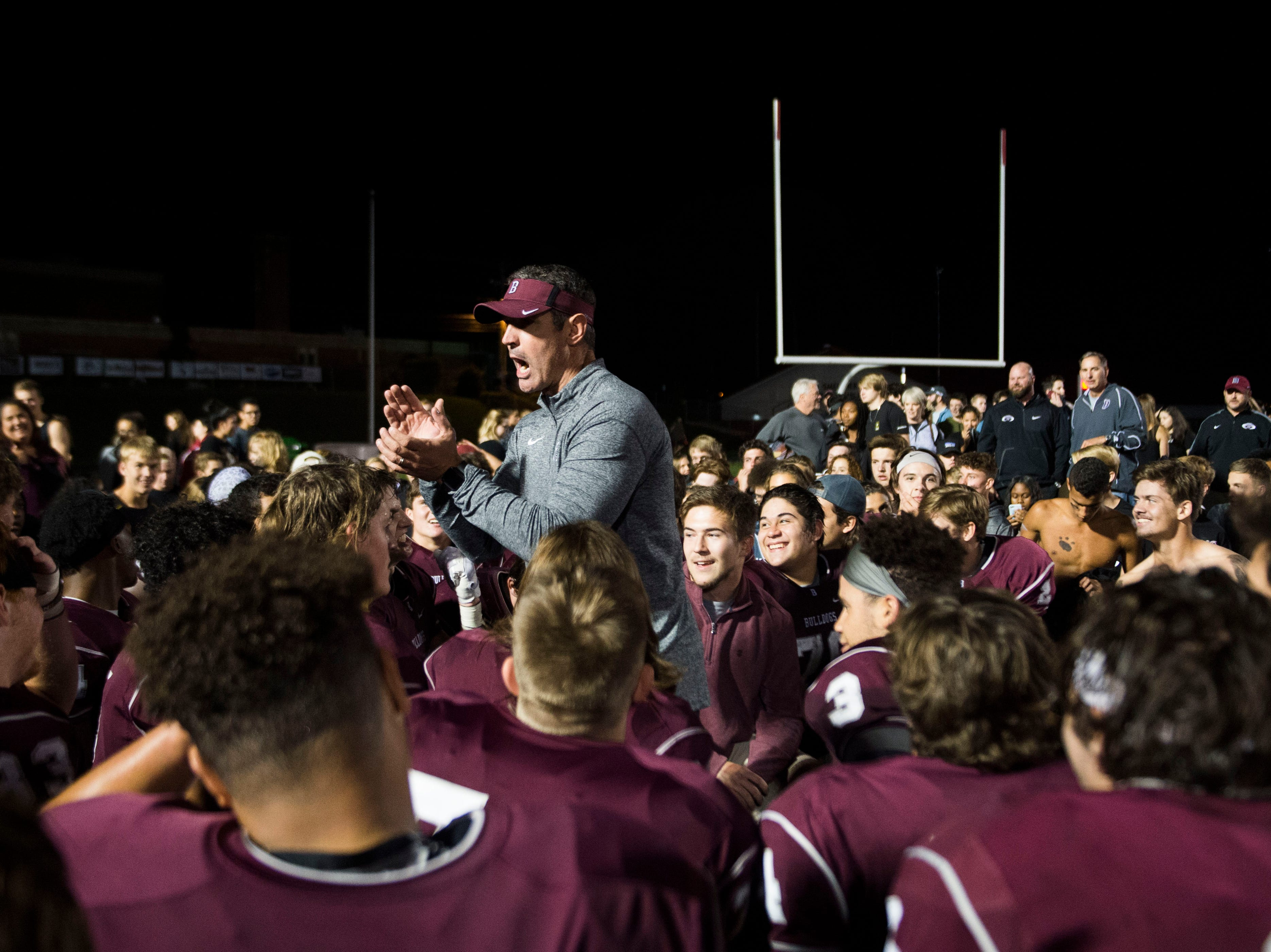 Bearden's head coach Morgan Shinlever talks to players after a game between Bearden and Farragut at Bearden Thursday, Oct. 11, 2018. Bearden took down Farragut 17-13.