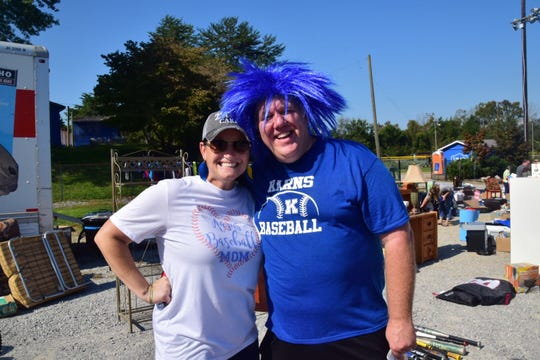 Organizers Jamie Ferrell, Karns High School Baseball Booster Club president, and Ron Garrett, baseball parent, raise money for a new concession stand and press box for the Karns High School baseball field at a rummage sale Saturday, Oct. 6.