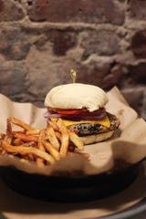 Stock & Barrel cheeseburger with fries.