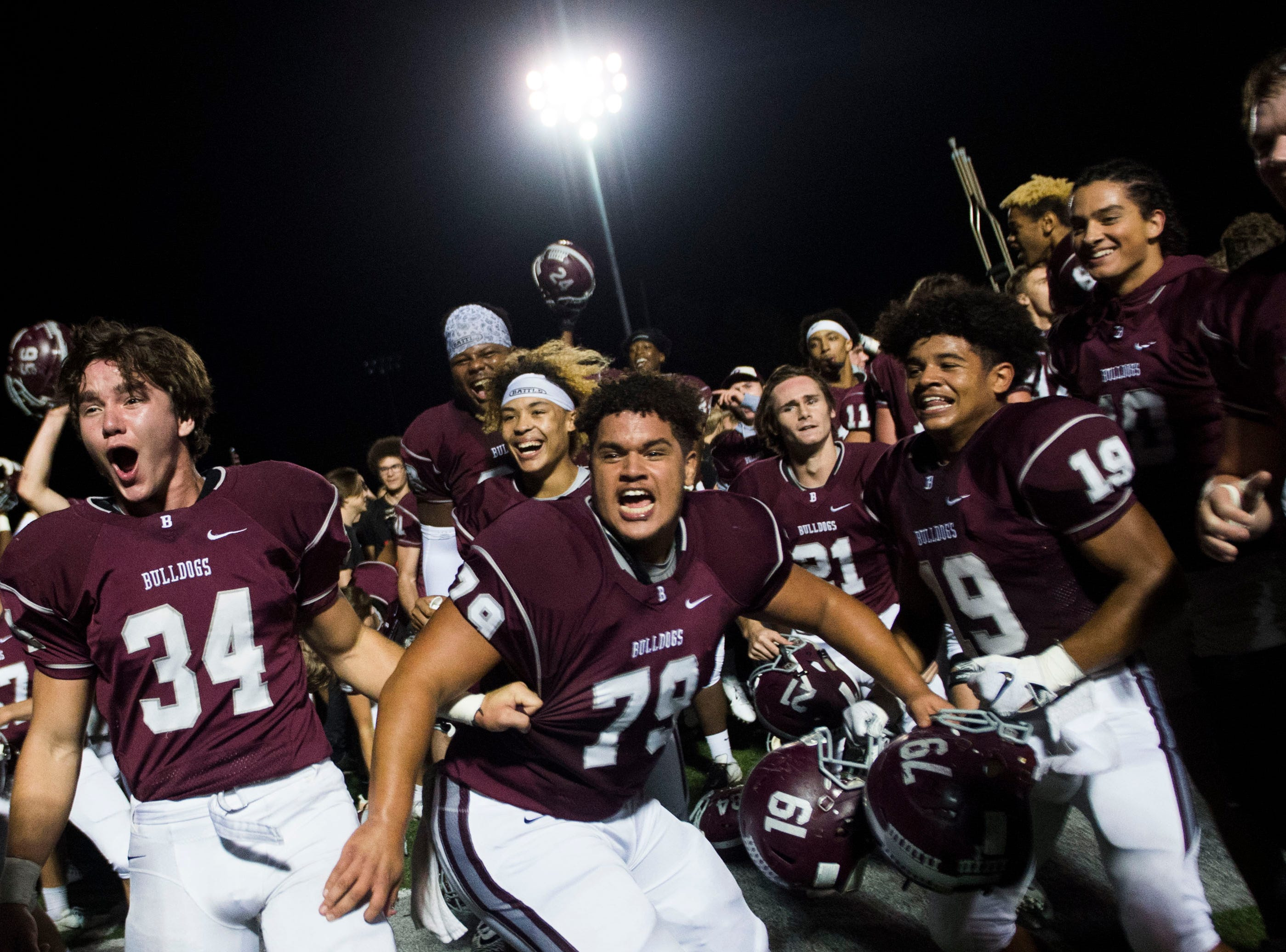Bearden celebrates their win after a game between Bearden and Farragut at Bearden Thursday, Oct. 11, 2018. Bearden took down Farragut 17-13.