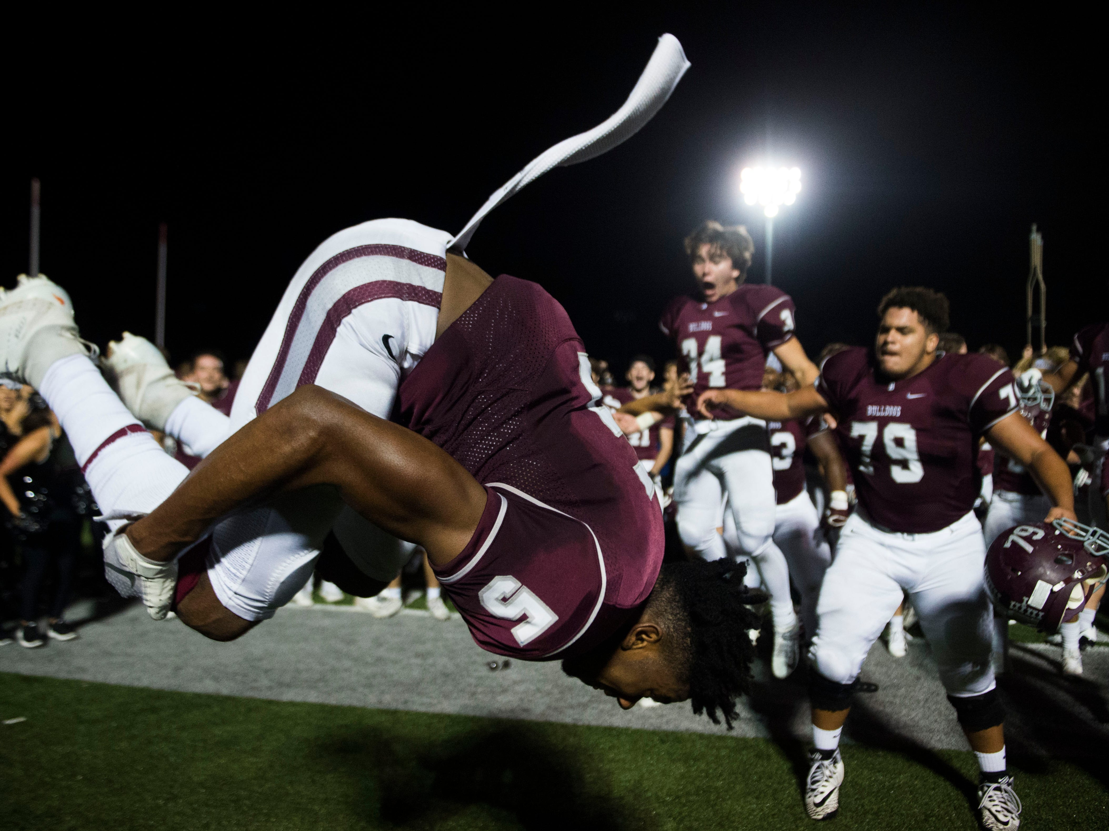 Bearden's Kahlil  Abdullah (5) does a flip in celebration after a game between Bearden and Farragut at Bearden Thursday, Oct. 11, 2018. Bearden took down Farragut 17-13.
