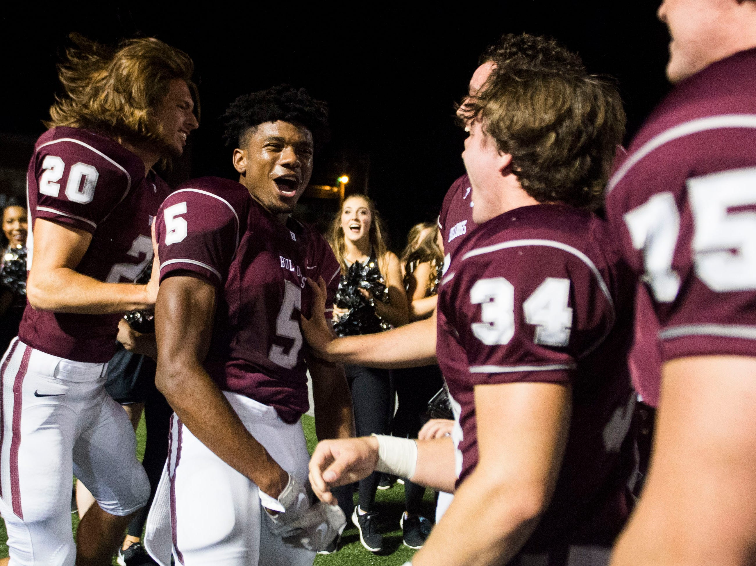 Bearden players celebrate after a game between Bearden and Farragut at Bearden Thursday, Oct. 11, 2018. Bearden took down Farragut 17-13.